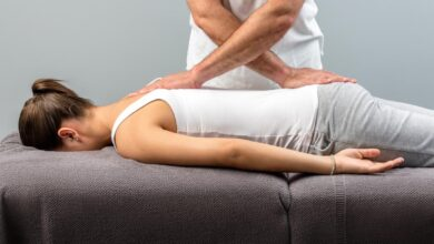 chiropractor working on woman s back
